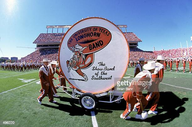 Band Members of the Texas Longhorns pull around a big drum at half time during a game against the Nebraska Cornhuskers at the Texas Memorial Stadium...
