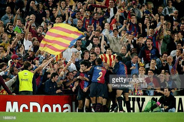 Barcelona celebrate Luis Figo's goal against Real Madrid during the Spanish Primera Liga match at the Nou Camp in Barcelona Spain The game ended 22...
