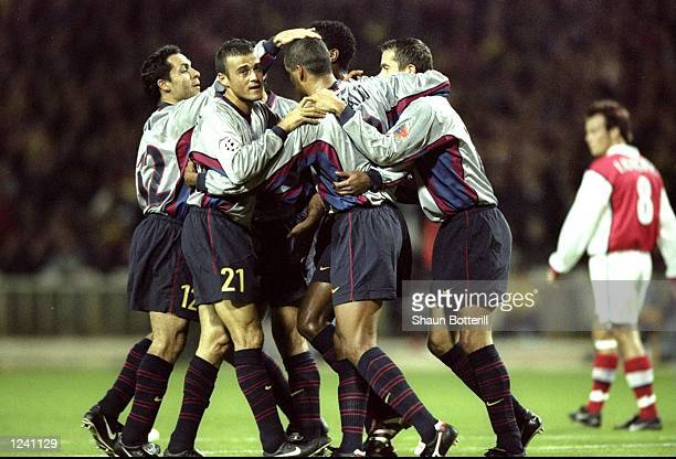 Barcelona celebrate Rivaldo's opening goal during the Champions League Group B match against Arsenal played at Wembley Stadium London The game...