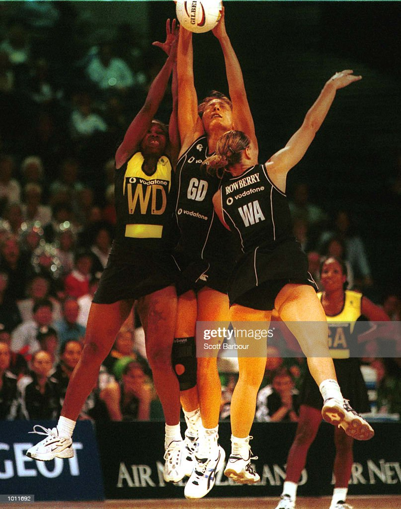 Bernice Mene (centre) grabs the ball during the New Zealand v Jamaica semi-final game in the 1999 World Netball Championships held at the WestPac Trust Centre, Christchurch, New Zealand. New Zealand beat Jamaica 55-53. Mandatory Credit: Scott Barbour/ALLSPORT