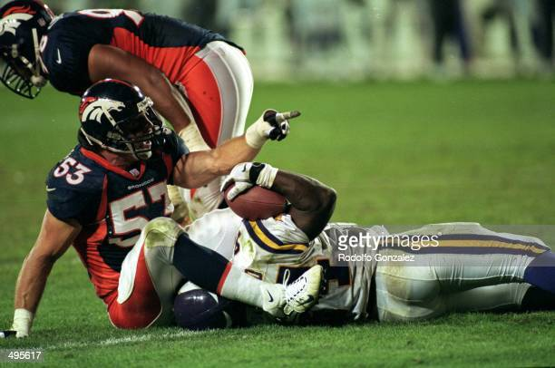 Bill Romanowski of the Denver Broncos makes the tackled during a game against the Minnesota Vikings at the Mile High Stadium in Denver Colorado The...