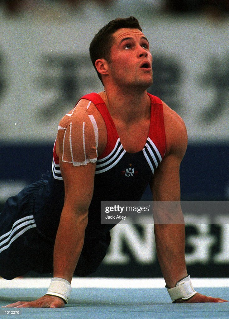 Blaine Wilson of the United States performs his floor routine during the mens teams final at the 1999 Tianjin World Gymnastics Championships, Tianjin, China. The United States finished in sixth place overall. Mandatory Credit: Jack Atley/ALLSPORT