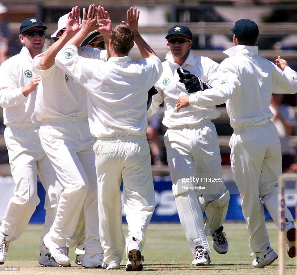 Bryan Strang of Zimbabwe celebrates with team mates after claiming the wicket of Michael Slater of Australia, during day two of the one off test match between Zimbabwe and Australia at Harare Sports Club, Harare, Zimbabwe.X Mandatory Credit: Hamish Blair/ALLSPORT