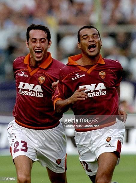 Cafu of Roma celebrates his goal with team mate Alessandro Rinaldi during the Serie A match against Fiorentina at the Artemio Franchi Stadium in...