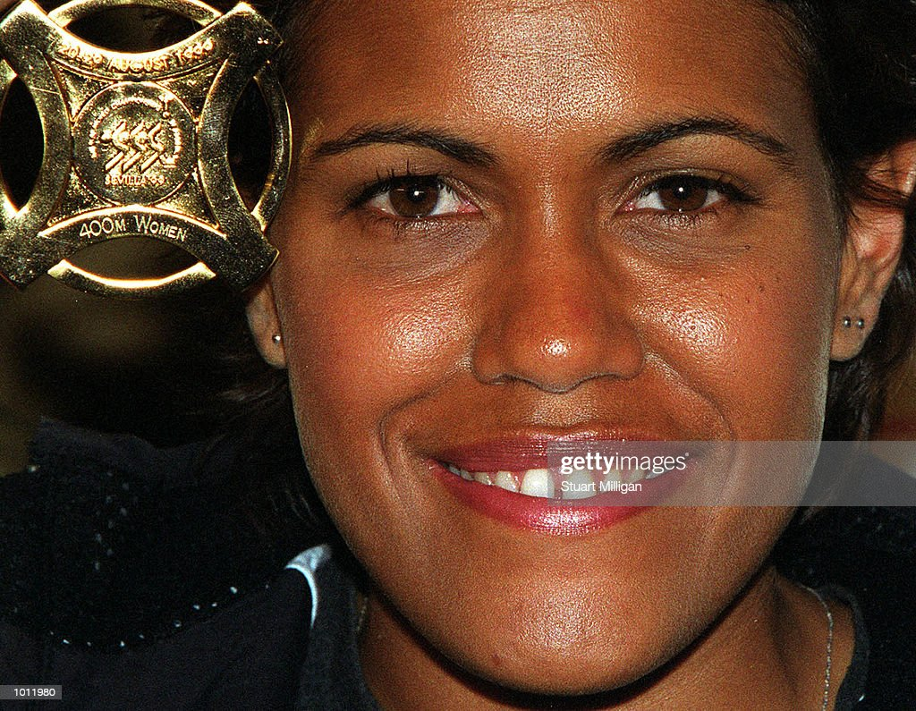 Cathy Freeman showes off her Gold medal for the World Championship victory in the womens 400m in Spain during a press conference which was held at the Hyatt Hotel, Melbourne, Australia. Mandatory Credit: Stuart Milligan/ALLSPORT