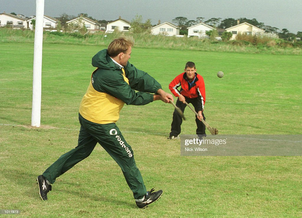 Chris Whitaker of Australia enjoys a game of Hurling with a local boy during a training session at the Portmarnock Sport Centre, Dublin, Ireland. Ahead of Australia's match against Ireland at Landsdown Road on Sunday. Mandatory Credit: NickWilson/ALLSPORT