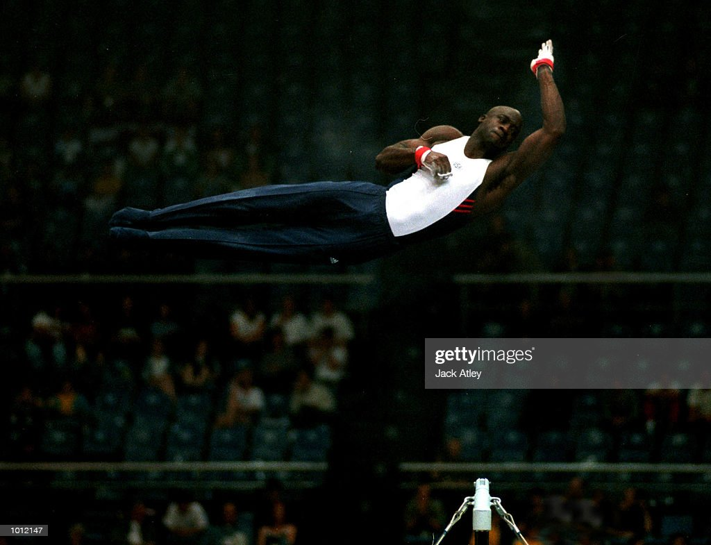 Chris Young of the United States flies over the top during his horizontal bar routine during the mens qualifying round at the 1999 Tianjin World Gymnastics Championships, Tianjin, China. Mandatory Credit: Jack Atley/ALLSPORT