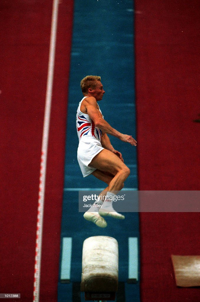 Craig Heap of Great Britain flies off the vault during the all round individual mens competition final at the 1999 Tianjin World Gymnastics Championships, Tianjin, China. Heap finished in 32nd place overall. Mandatory Credit: Jack Atley/ALLSPORT