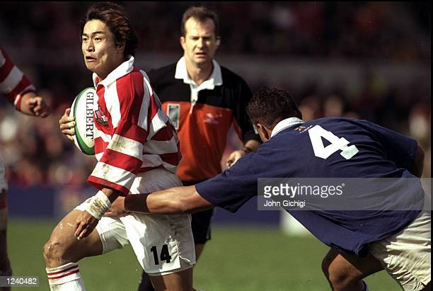 Daisuke Ohata of Japan in action during the Rugby World Cup match against Samoa played at the Racecourse Ground in Wrexham England Samoa won the game...