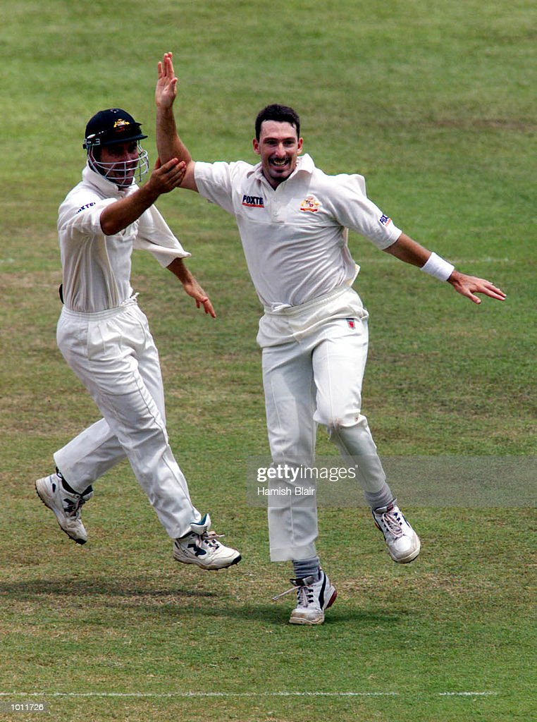 Damien Fleming of Australia celebrates with Justin Langer after having Marvan Atapattu of Sri Lanka caught behind by Ian Healy, on day four of the 3rd Test between Sri Lanka and Australia at Singhalese Sports Club, Colombo, Sri Lanka.X Mandatory Credit: Hamish Blair/ALLSPORT