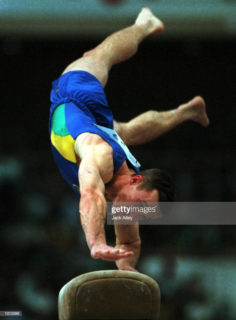 Damien Istria of Australia lunges during his vault routine during the mens qualifying round at the 1999 Tianjin World Gymnastics Championships, Tianjin, China. Mandatory Credit: Jack Atley/ALLSPORT