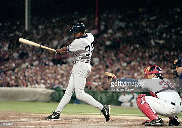 Darryl Strawberry of the New York Yankees hits the ball during the ALCS game two against the Boston Red Sox at Fenway Park in Boston Massacusetts The...