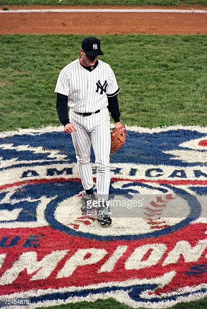 David Cone of the New York Yankees walks over the ALCS Logo during the American League Championships Series game two against the Boston Red Sox at...