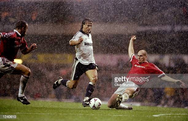 David Ginola of Tottenham Hotspur takes on Jaap Stam of Manchester United during the FA Carling Premiership match at White Hart Lane in London Spurs...