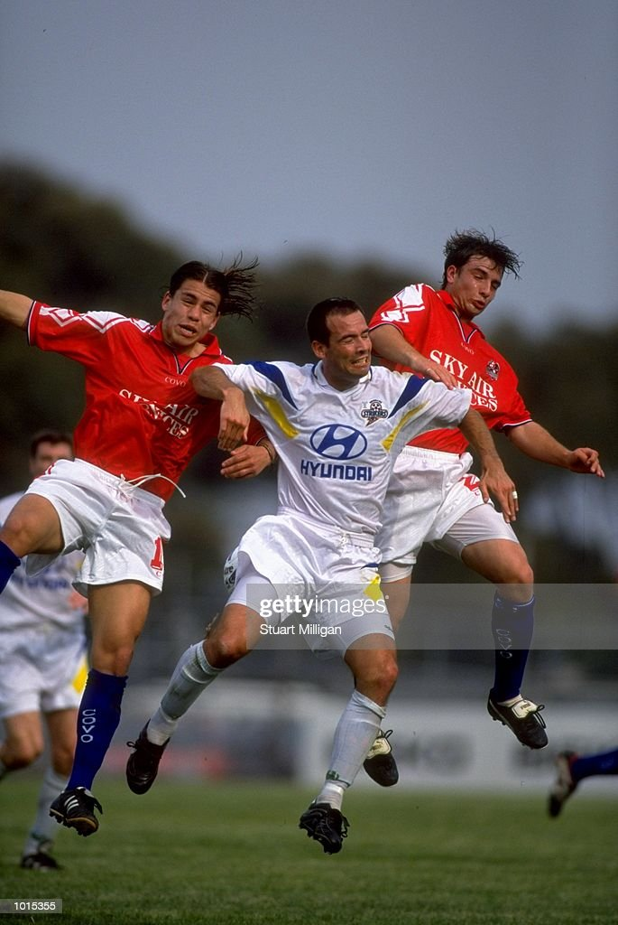 David Pilic of the Brisbane Strikers is sandwiched between Roddy Vargas and Joey Rajher of the Melbourne Knights during the National Soccer League Round 1 match played at Knights Stadium in Melbourne, Australia. The game finished in a 1-0 win for the Brisbane Strikers. \ Mandatory Credit: Stuart Milligan /Allsport