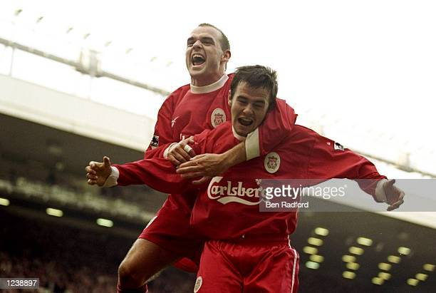 David Thompson of Liverpool is congratulated by team mate Danny Murphy after scoring against Chelsea during the FA Carling Premiership match at...