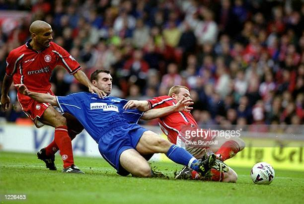 David Unsworth of Everton battles with Curtis Fleming and Phil Stamp of Middlesbrough during the FA Carling Premiership match at the Riverside in...