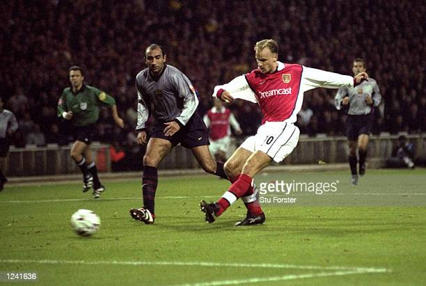 Dennis Bergkamp scores Arsenal's first goal during the UEFA Champions League Group B match against Barcelona played at Wembley Stadium London The...