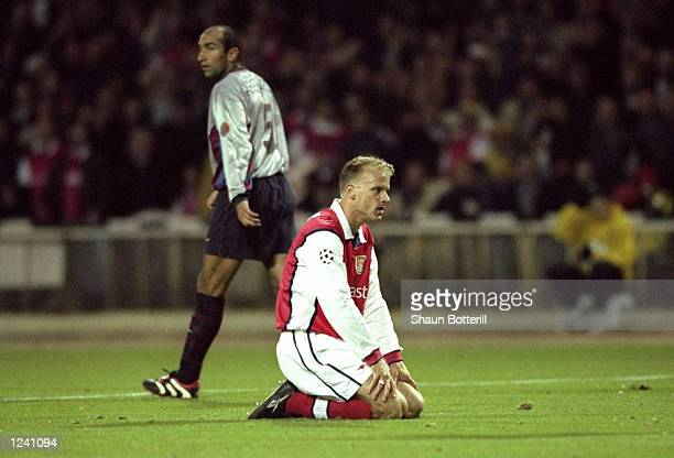 Despair for Arsenal's Dennis Bergkamp as another chance goes begging during the Champions League Group B match against Barcelona played at Wembley...