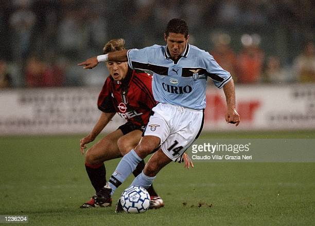 Diego Simeone of Lazio goes past Massimo Ambrosini of AC Milan during the Serie A match at the Stadio Olimpico in Rome Italy Mandatory Credit Claudio...