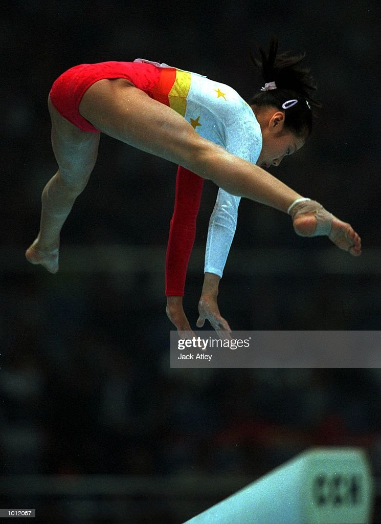 Fangxiao Dong of China leaps high during her balance beam routine during the womens qualifying round at the 1999 Tianjin World Gymnastics Championships, Tianjin, China. China finished fourth overall after the qualifying sessions. MandatoryCredit: Jack Atley/ALLSPORT