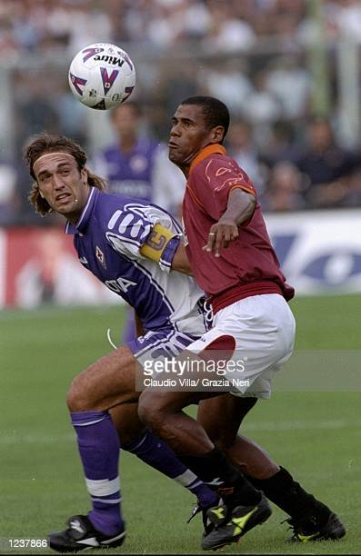 Gabriele Batistuta of Fiorentina holds off Aldair of Roma during the Serie A match at the Artemio Franchi Stadium in Florence Italy Roma won 31...