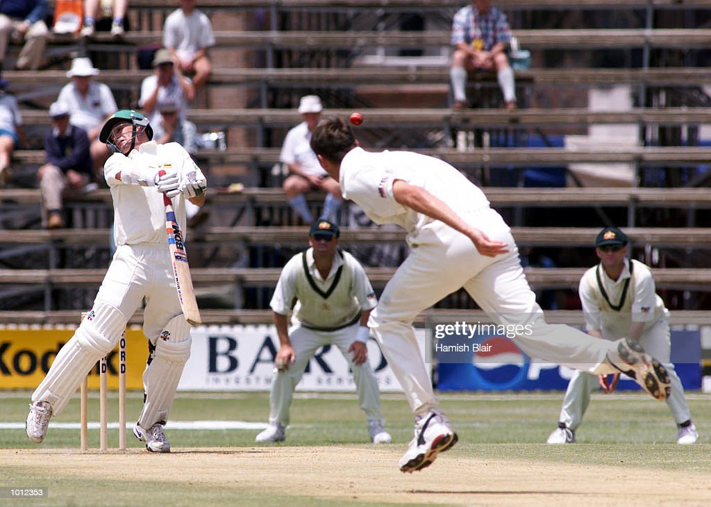 Gavin Rennie of Zimbabwe rears up after being struck by a delivery off the bowling of Glenn McGrath of Australia, during day one of the one off test match between Zimbabwe and Australia at Harare Sports Club, Harare, Zimbabwe.X Mandatory Credit: Hamish Blair/ALLSPORT