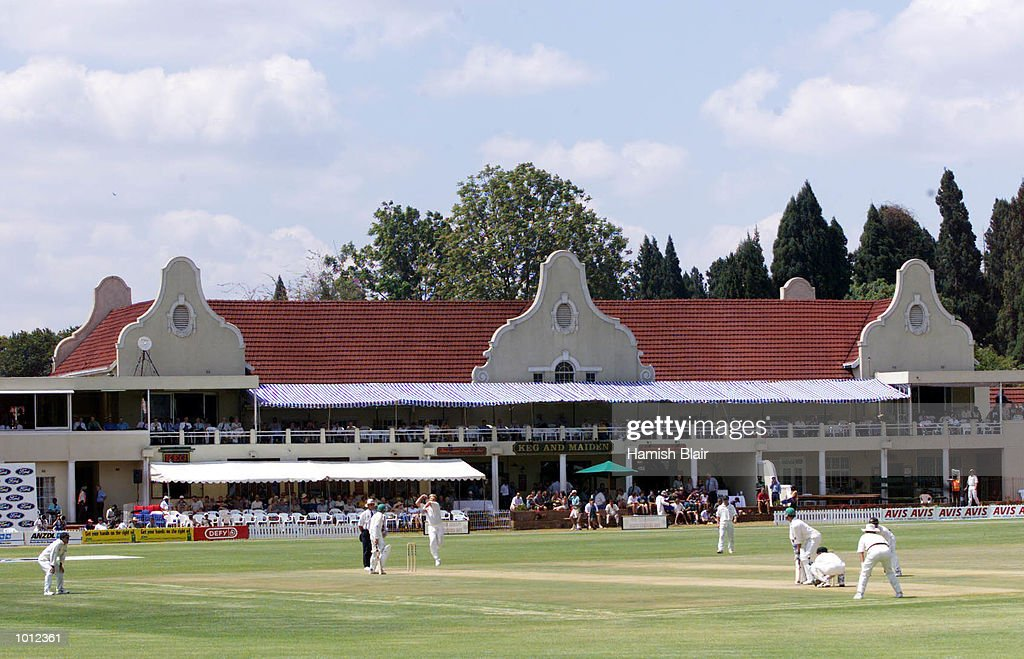 General view of Shane Warne of Australia bowling with 'Keg and Maiden' pub in background, during day one of the one off test match between Zimbabwe and Australia at Harare Sports Club, Harare, Zimbabwe.X Mandatory Credit: Hamish Blair/ALLSPORT