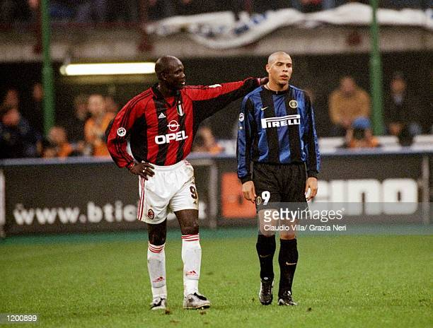 George Weah of AC Milan consoles Ronaldo of Inter Milan after his sending off during the Serie A match at the San Siro in Milan Italy Mandatory...