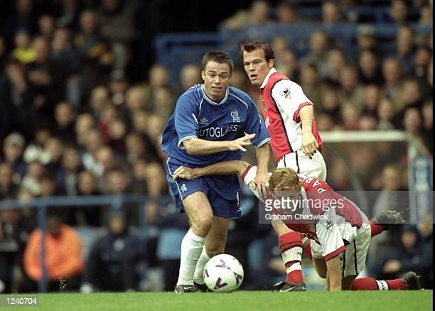 Graeme Le Saux Chelsea tackles Arsenal's Ray Parlour during the FA Carling Premier League match played at Stamford Bridge London The game finished in...