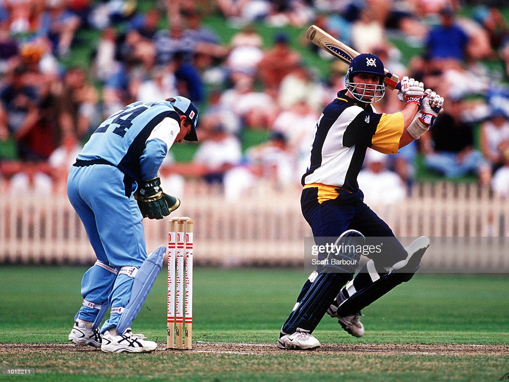 Graeme Vimpani of the Victorian Bushrangers cuts in front of point as wicketkeeper Brad Haddin of the NSW Blues looks on during the Mercantile Mutual Cup fixture at the North Sydney Oval, Sydney, Australia. Mandatory Credit: Scott Barbour/ALLSPORT