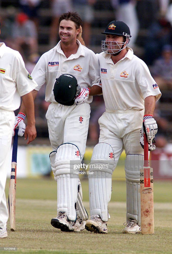 Greg Blewett (left) and Michael Slater of Australia congratulate one another as Australia wins the test, during day four of the one off test match between Zimbabwe and Australia at Harare Sports Club, Harare, Zimbabwe.Australia won by 10 wicketsX Mandatory Credit: Hamish Blair/ALLSPORT
