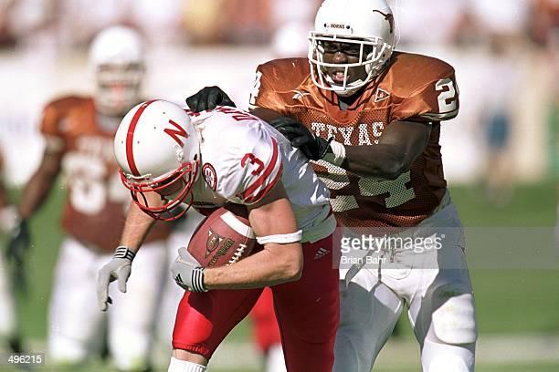 Greg Brown of the Texas Longhorns tackles Matt Davidson of the Nebraska Cornhuskers at the Texas Memorial Stadium in Austin Texas The Longhorns...