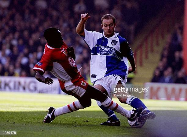 Greg Goodridge of Bristol City tackles David Hillier of Bristol Rovers during the Nationwide Division Two match at Ashton Gate in Bristol England The...