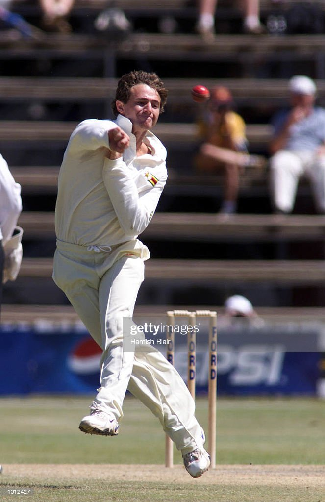 Guy Whital of Zimbabwe attempts unsuccessfully to run out Mark Waugh of Australia, during day two of the one off test match between Zimbabwe and Australia at Harare Sports Club, Harare, Zimbabwe. Mandatory Credit: Hamish Blair/ALLSPORT