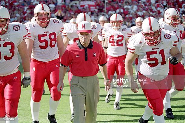Head coach Frank Solich of the Nebraska Cornhuskers walks out on the field with his players before a game against the Texas Longhorns at the Texas...