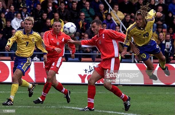 Henrik Larsson of Sweden goes close with a diving header during the vital Euro 2000 qualifier in Rasunda Stadium Stockholm Sweden Mandatory Credit...