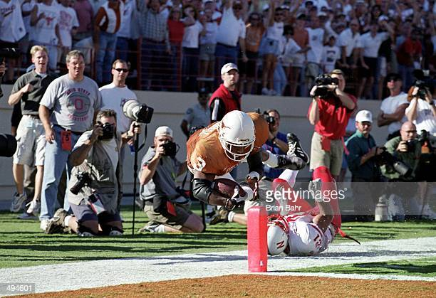 Hodges Mitchell of the Texas Longhorns is tackled neer the goal line during the game against the Nebraska Cornhuskers at the Texas Memorial Stadium...