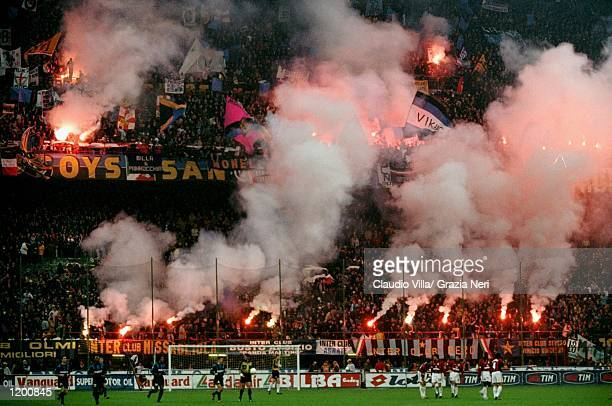 Inter Milan fans light flares during the Serie A match against AC Milan at the San Siro in Milan Italy Mandatory Credit Claudio Villa /Allsport