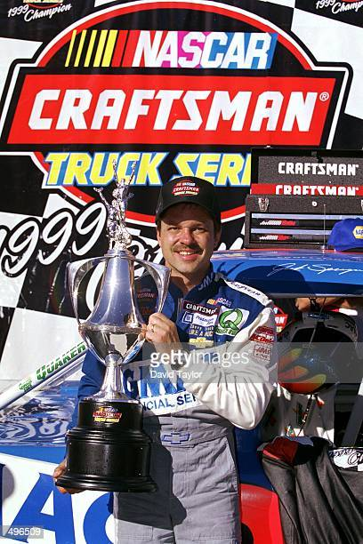 Jack Sprague poses with his trophy after winning the NAPA Auto Parts 200 part of the NASCAR Craftsman Truck Series at the California Speedway in...