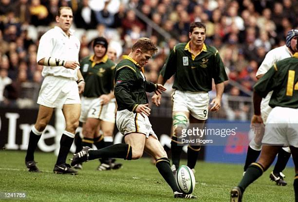 Jannie De Beer of South Africa kicks his fourth drop goal against England in the Rugby World Cup quarterfinal match at the Stade de France in Paris...