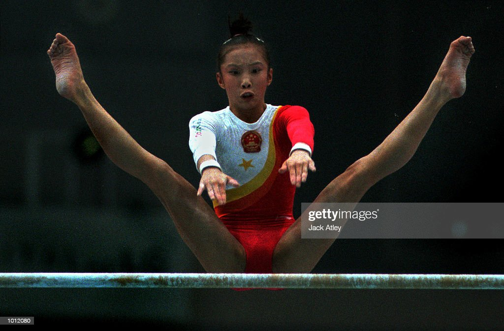 Jie Ling of China flies over the top bar during her uneven bars routine during the womens qualifying round at the 1999 Tianjin World Gymnastics Championships, Tianjin, China. China finished fourth overall after the qualifying sessions. Mandatory Credit: Jack Atley/ALLSPORT