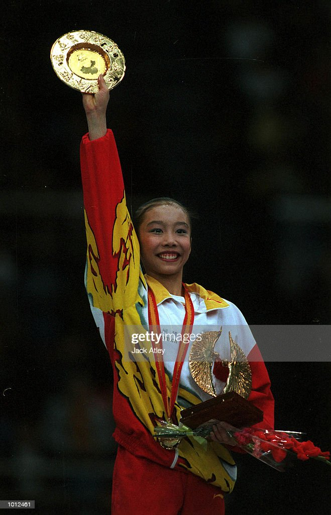 Jie Ling of China salutes the crowd after winning the the gold medal for the balance beam during the individual apparatus womens finals competition at the 1999 Tianjin World Gymnastics Championships, Tianjin, China. Mandatory Credit: Jack Atley/ALLSPORT