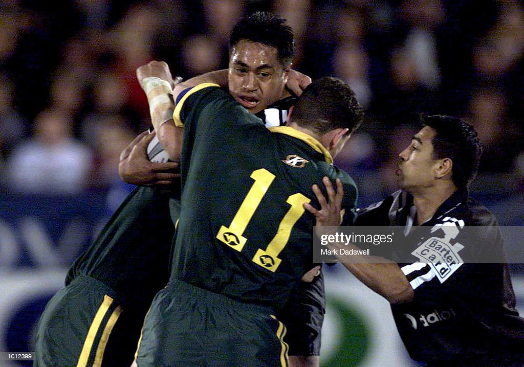 Joe Vagana of the New Zealand is tackled by #11 Brian Fletcher of Australia during the first Tri Nations match between New Zealand v Australia played at Ericsson Stadium, Auckland, New Zealand. Mandatory Credit: Mark Dadswell/ALLSPORT