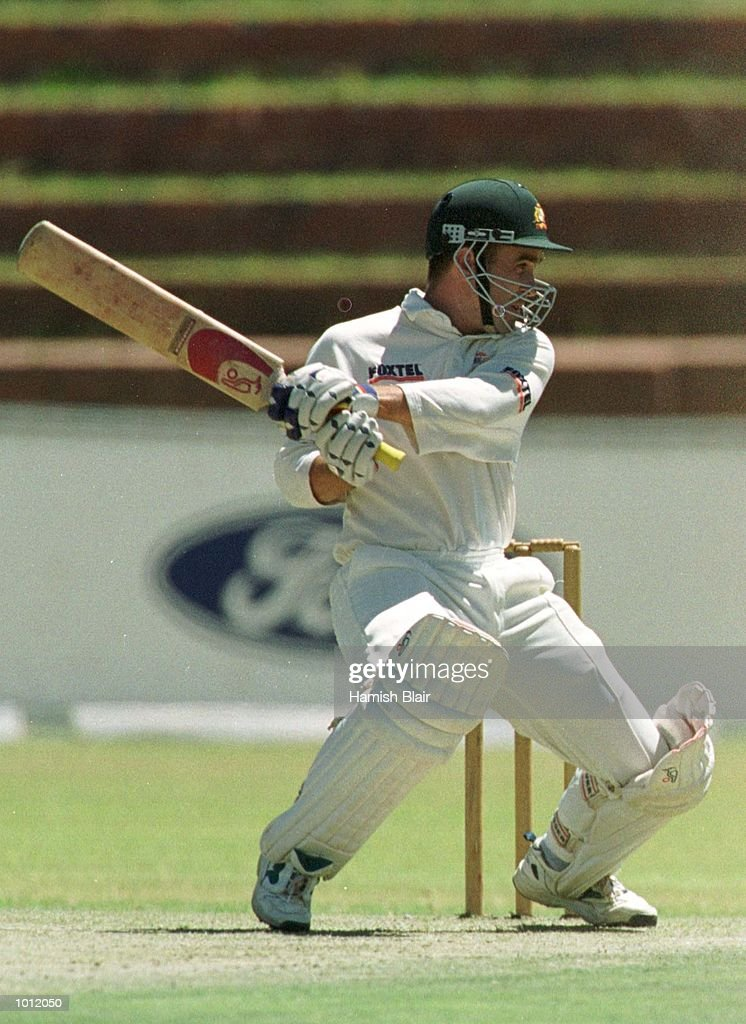 Justin Langer of Australia, hits out, during the tour match between the Zimbabwe President's XI and Australia at Queens Sports Club, Bulawayo, Zimbabwe. Mandatory Credit: Hamish Blair/ALLSPORT