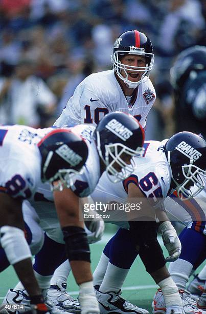 Kent Graham of the New York Giants calls the count from the line of scrimmage during the game against the Philadelphia Eagles at the Veteran Stadium...