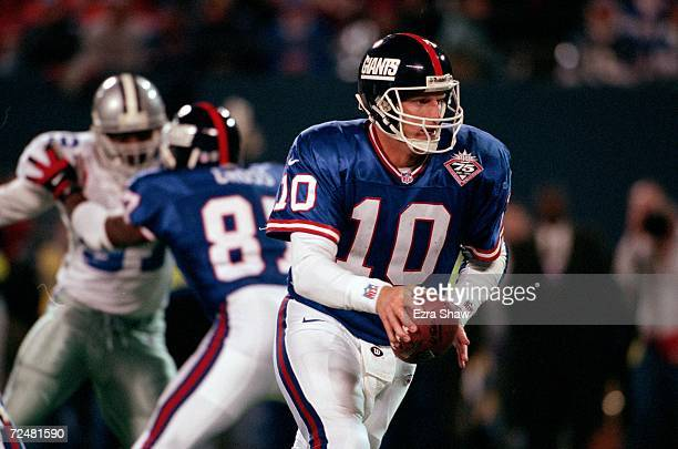 Kent Graham of the New York Giants hands off the ball during a game against the Dallas Cowboys at the Giants Stadium in East Rutherford New Jersey...