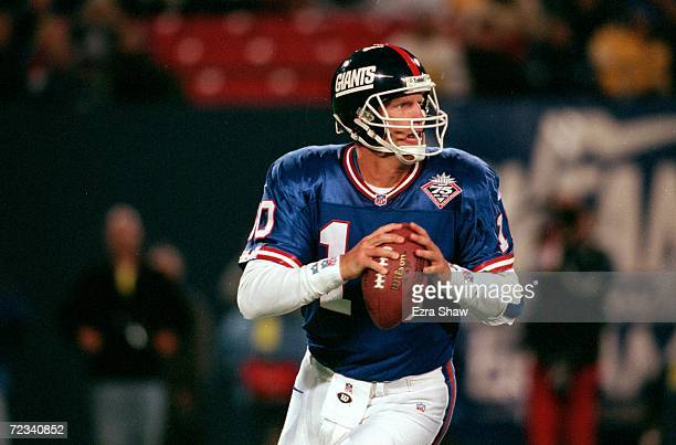 Kent Graham of the New York Giants looks to pass the ball during the game against the Dallas Cowboys at the Giants Stadium in East Rutherford New...