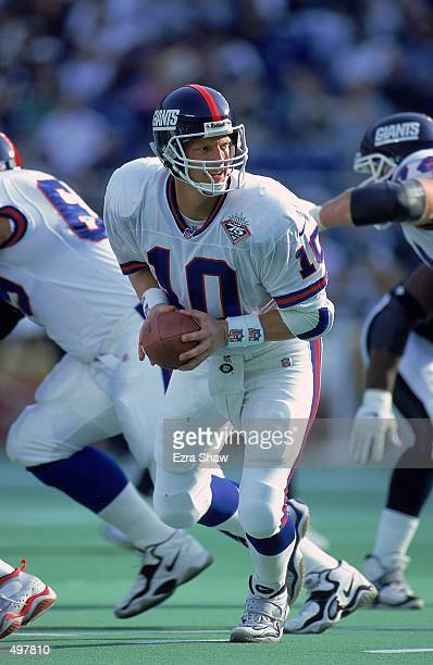 Kent Graham of the New York Giants moves with the ball during the game against the Philadelphia Eagles at the Veteran Stadium in Philadelphia...