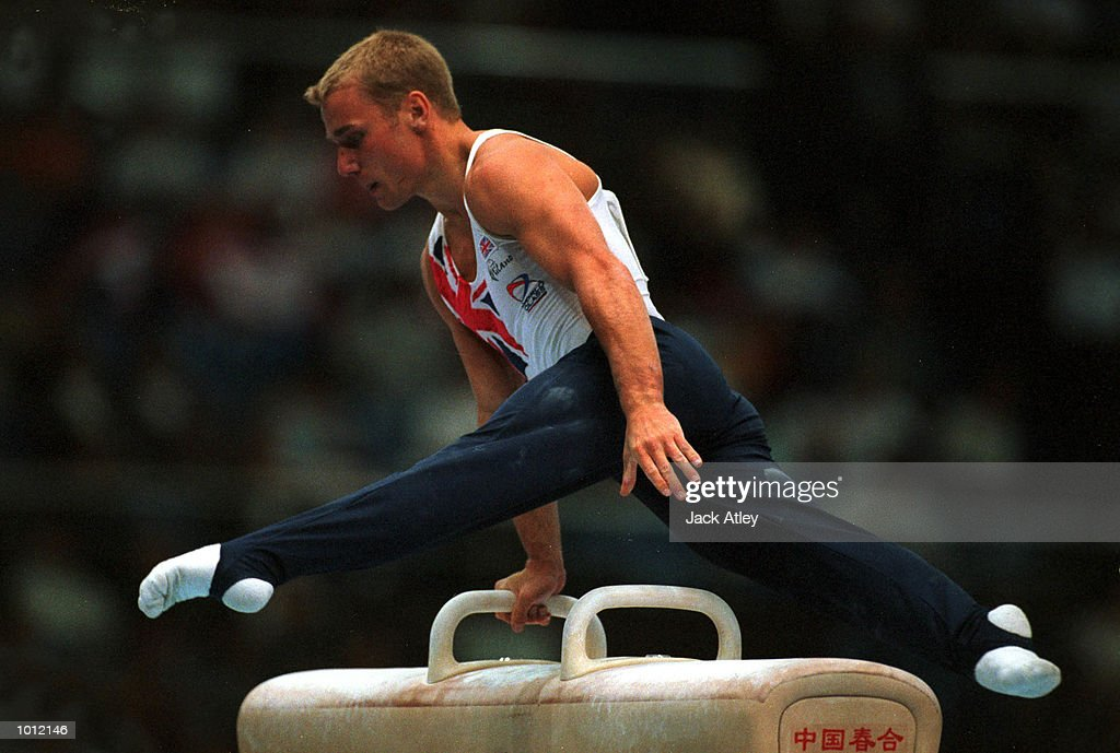 Kevin Atherton of Great Britain performs his pommel horse routine during the mens qualifying round at the 1999 Tianjin World Gymnastics Championships, Tianjin, China. Mandatory Credit: Jack Atley/ALLSPORT